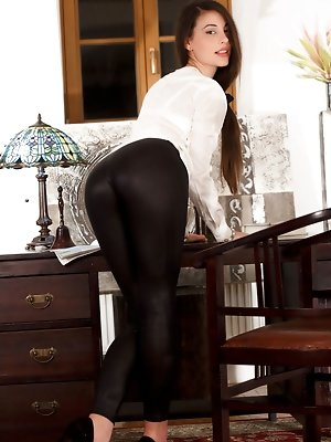 Beauty, brains and Lorena B, looking stunning in her black leggings, white blouse and black stilettos. Add some glasses to the mix and you get the sex